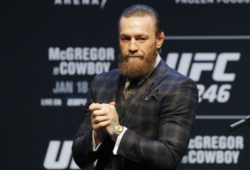 A reporter was loudly booed by MMA fans at a UFC event after asking Conor McGregor about the sexual assault allegations made against him