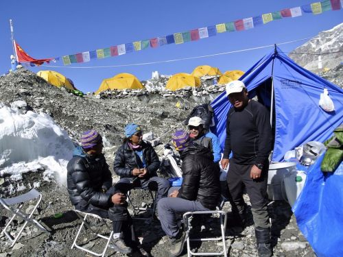 Everest is becoming a conveyor belt of hikers who pay $25,000 to do the climb - these images reveal what the trek really looks like