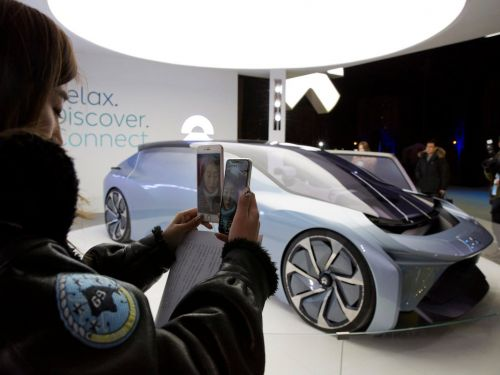 China's top electric car startup is using Apple's playbook in China to take on Tesla