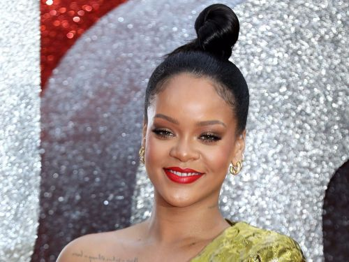 Rihanna almost had a wardrobe malfunction when her dress slipped off her shoulder on the red carpet