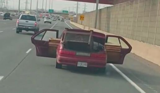 Watch a Chevy Lumina Drive Down a Highway With Lumber Protruding From Its Open Doors