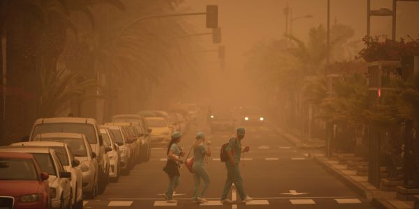 Eerie photos show a massive Saharan sand storm blanketing the Canary Islands in orange dust