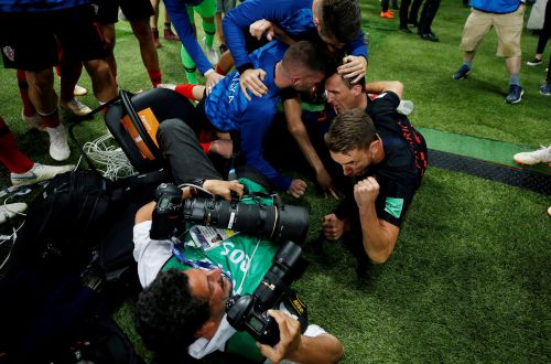 A World Cup photographer was run over during Croatia's goal celebration, still did his job, and captured some amazing pics