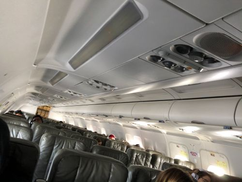 I flew economy from New York to Austin during the coronavirus pandemic, and it was the quietest flight I've ever been on. Here's what it's like to fly on a ghost plane during the outbreak