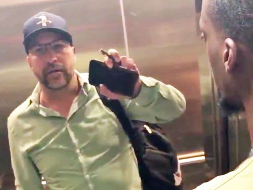 A white man is under police investigation after pulling out a gun on a group of black college students trying to use an elevator