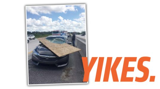 Florida Driver's Windshield Sliced By Flying Plywood