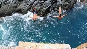 Acapulco professional cliff divers are risking lives and putting up daily shows for tourists
