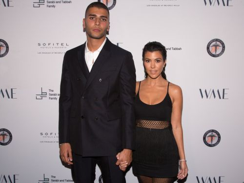 Kourtney Kardashian's boyfriend joked that he is 'ok' with her latest Instagram post after disapproving of her recent bikini picture