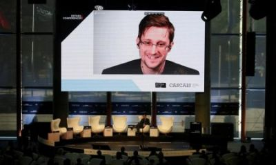 Putin says Snowden was wrong to leak secrets, but is no traitor