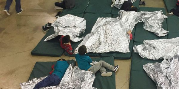 Photos show Border Patrol's largest processing facility, a former warehouse where families are separated and hundreds of migrant children are kept in cages