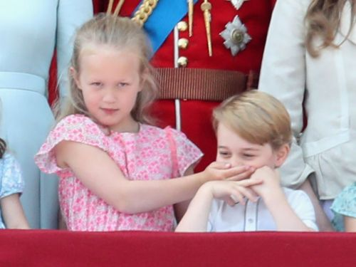 Prince George had to be silenced by his cousin on the balcony of Buckingham Palace and we can't stop laughing