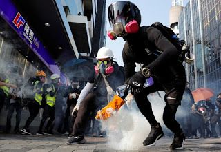 Petrol bombs and tear gas scar Hong Kong streets as police, protesters clash