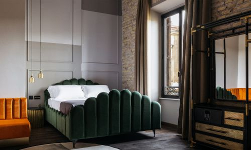 Uncover an Industrial-Chic Hotel Hideaway Lurking in Rome's 'Street of Blacksmiths'