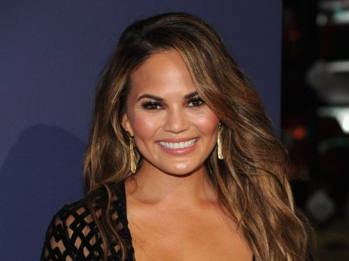 Chrissy Teigen shared an empowering breastfeeding photo - but haters can only focus on the fact that she's topless