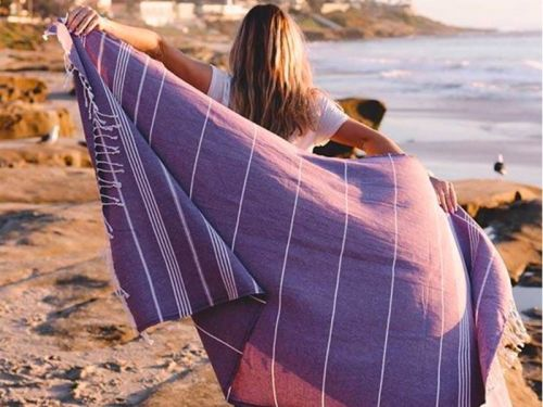 This beach towel company has done $20 million in sales after an appearance on 'Shark Tank' - and donates 10% of profits to help save marine life