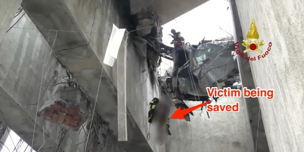 Dramatic rescue video shows a victim of the Italy bridge collapse being saved from a crushed vehicle dangling above the ground