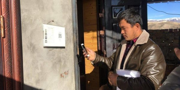 China is reportedly tracking ethnic minorities by sticking QR codes with their personal information on their front doors