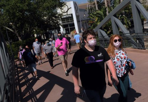 Disney Springs reopened this week, but it's not the same. Check out these pictures of what visiting the resort is now like, with mandatory mask, fever checks, and social distancing