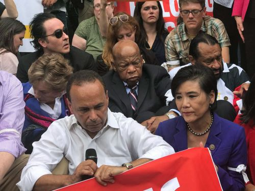 Several congressional leaders - and John Cusack - staged a sit-in in front of the US Customs and Border Protection offices
