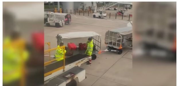 A Ryanair passenger filmed a baggage handler carelessly throwing luggage to the ground