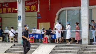 Central Chinese city closes tourist sites, cinemas after new infections emerge