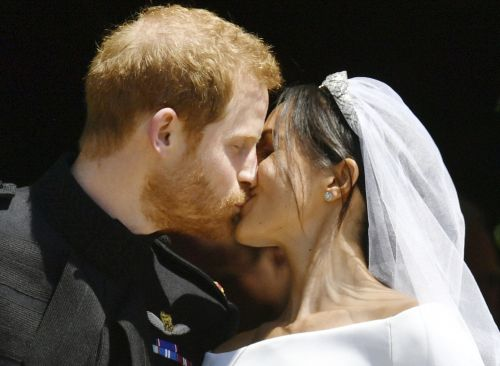Prince Harry and Meghan Markle just shared their first kiss as husband and wife