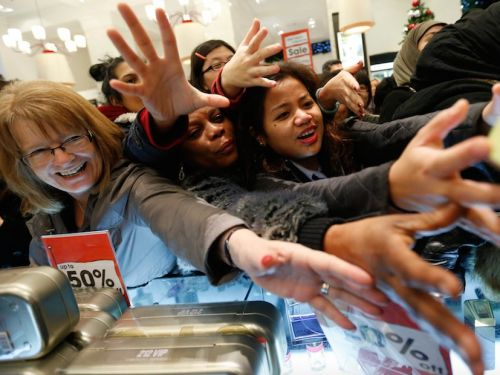 Americans are feeling good about shopping, and Macy's survival might depend on it