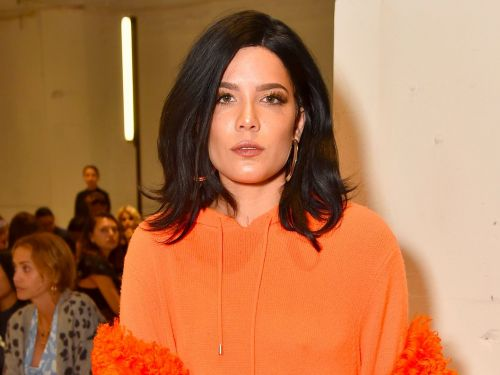 Halsey says hotels provide shampoos that 'alienate people of color' - and her tweets are sparking a debate over white privilege