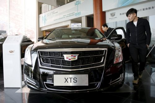 China cuts tariffs on auto imports as talk of Trump's trade war eases
