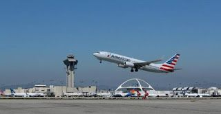 American cuts second U.S.-China flight; cites fuel cost, competition