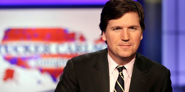 Tucker Carlson says the man he's accused of assaulting at a Virginia country club called his teenage daughter a 'w--'