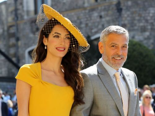 Amal Clooney wore a yellow dress to the 2018 royal wedding and looks stunning