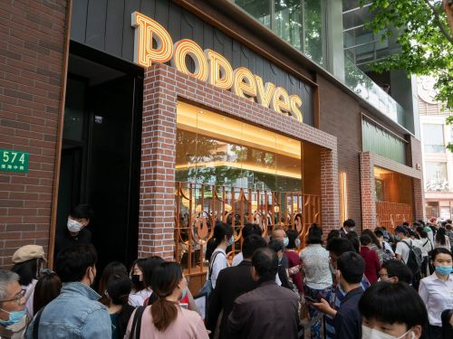 Popeyes just launched its first store in China, and photos show how not even a pandemic can keep a horde of fans from their chicken sandwich