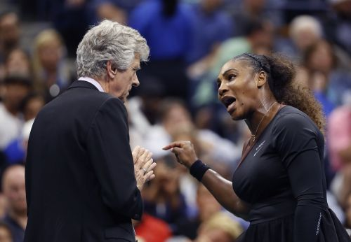 The cartoonist who turned Serena Williams into an angry baby doesn't think his drawing is racist and says 'the world has just gone crazy'