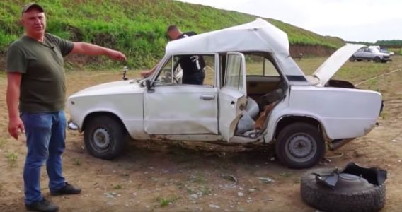 Man Over-Inflates a Tire and the Subsequent Explosion Destroys His Car