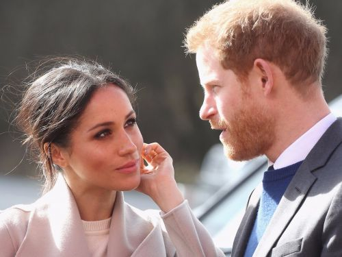 Prince Harry reportedly wants Meghan Markle to stop wearing pantsuits - here's what experts have to say about it