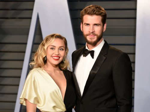 Miley Cyrus and Liam Hemsworth appeared to cut a wedding cake, and fans definitely think they're married