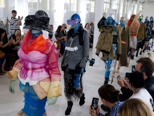 IPhone holsters for your ankle and colorful VR headsets were worn by models at a recent fashion show in Paris