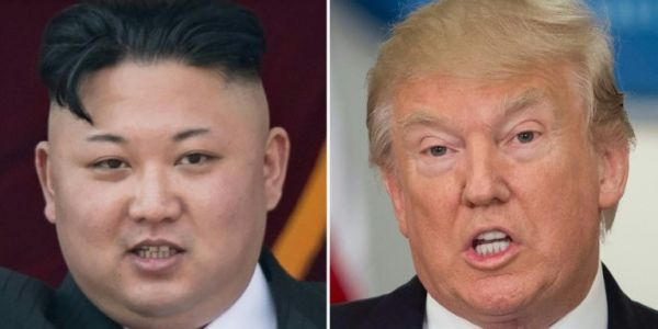Trump and North Korean leader Kim Jong Un meet for the first time in historic Singapore summit