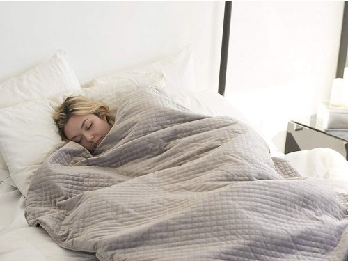 I slept under a 15-pound weighted blanket for a week - and it was the best sleep I've had in ages