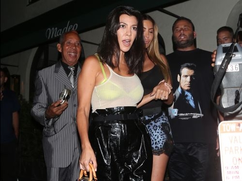 Kourtney Kardashian wore sheer neon heels with a matching bralette, making a case for the see-through trend