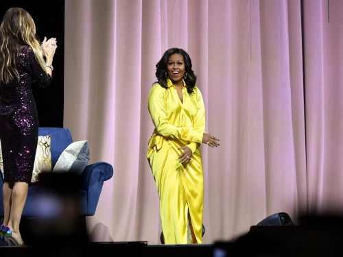 Michelle Obama says she wears dresses by young women, immigrants, and African-Americans because she knows it will 'change their lives'