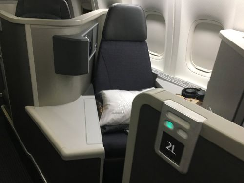 I flew in business class on American Airlines from New York City to London for only $5.60 - here's how I did it