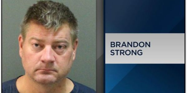 An 'intoxicated' JetBlue passenger was pepper-sprayed and arrested after allegedly attacking crew and wrestling with a police officer while trying to board a plane with his 8-year-old son