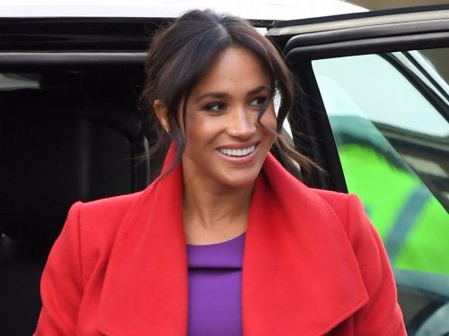 Meghan Markle turned heads in a bright red coat and purple dress that channeled the Queen and Princess Diana