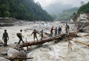 Flash floods, landslides kill at least 22 in northern India