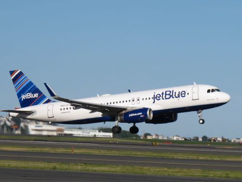 JetBlue is laying off workers and reshuffling jobs as it moves to cut $300 million in costs