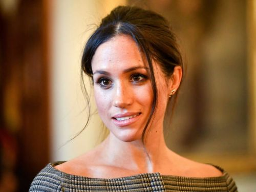 Meghan Markle is having Prince Charles escort her down the aisle - but she'll reportedly walk most of it by herself