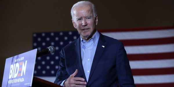 Biden slams Trump in new campaign ad for playing golf over Memorial Day weekend as 'nearly 100,000 Americans have died'