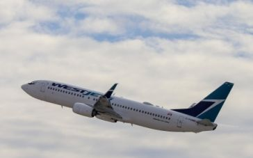 WestJet enhances no-charge COVID-19 travel insurance offering with U.S. coverage